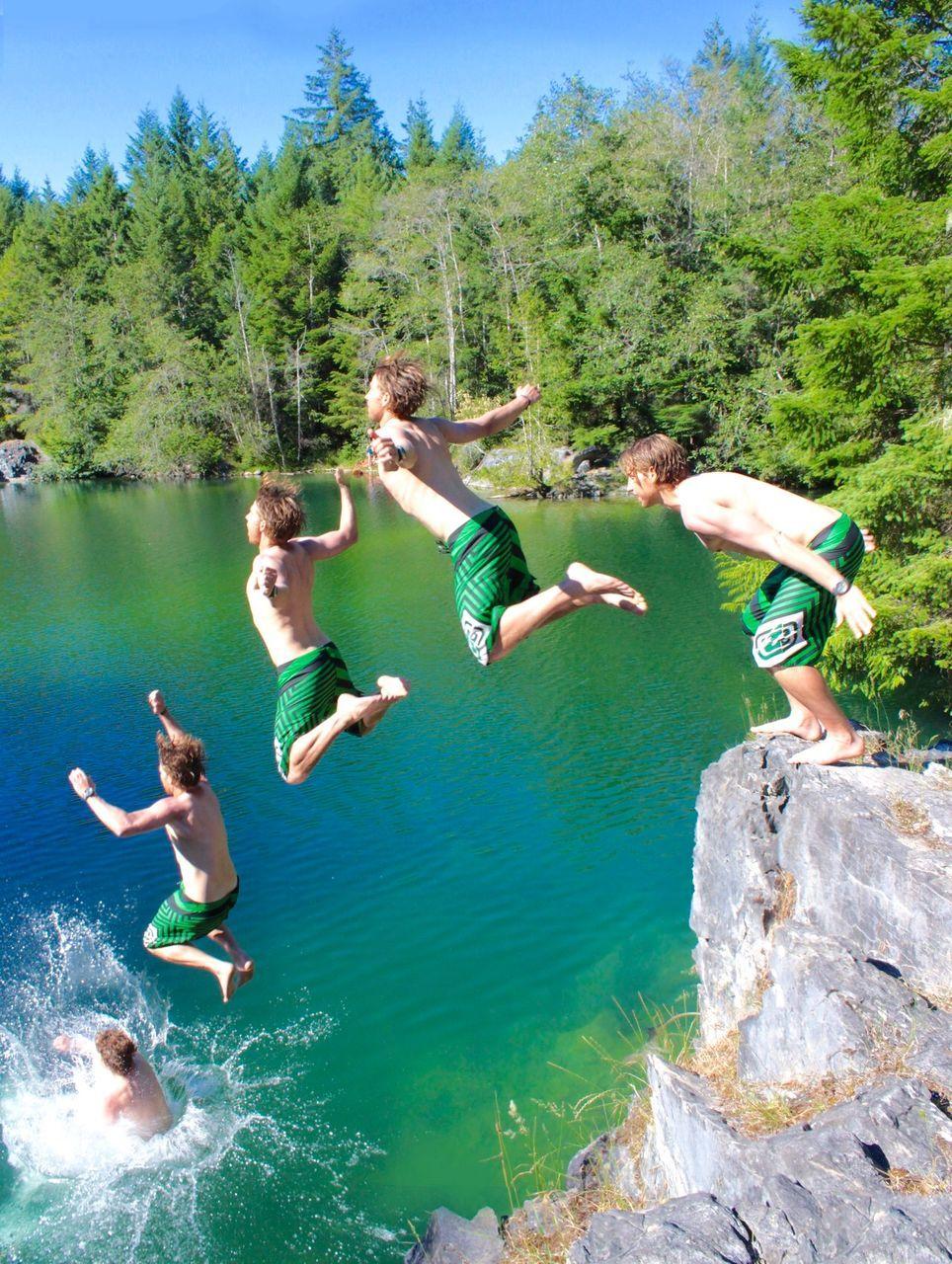 Multiple Image Of Shirtless Man Jumping In Lake