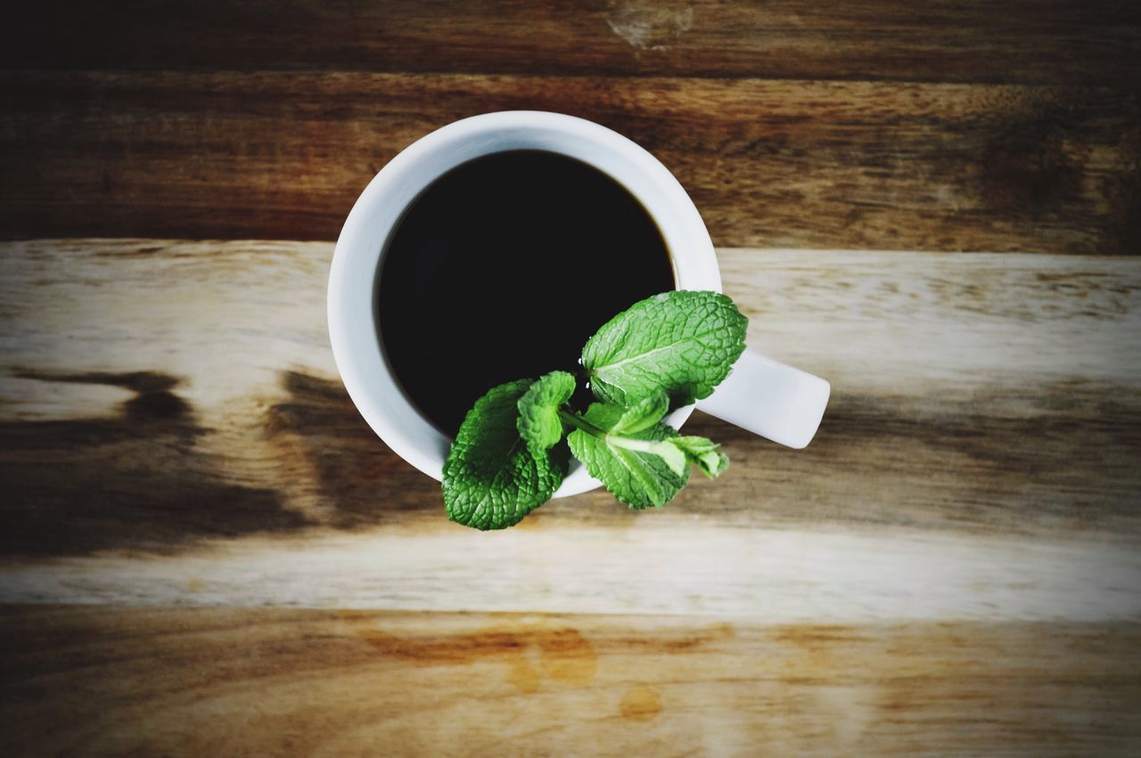 Coffee with spearmint plant on wood surface. Table Leaf Wood - Material Healthy Eating Green Color Freshness Drink Food Hot Beverage Cup Of Coffee Coffee Black Coffee Mint Herb Wood Herbal Mint Leaves Mint Tea Food And Drink Freshness Flatlay Flat Lay Coffee Flatlay Coffee - Drink Coffee Time Coffee Break