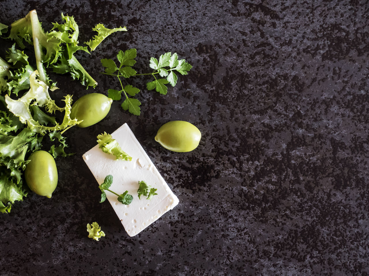 High angle view of Feta cheese with olives and green herbs on gray marble background Background Cheese Close-up Day Feta Food Freshness Gray Green Healthy Eating Healthy Lifestyle Herbs High Angle View Leaf Marble Nature No People Olives Outdoors Plant