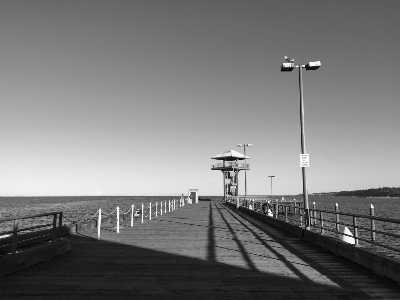 The pier at Port Angles, WA- where the mountains meet the sea. Sea Railing Clear Sky Built Structure Sky Outdoors Pier Water Nature Scenics Day Architecture The Way Forward Building Exterior Tranquility Horizon Over Water No People IPhoneography Blackandwhite Black And White