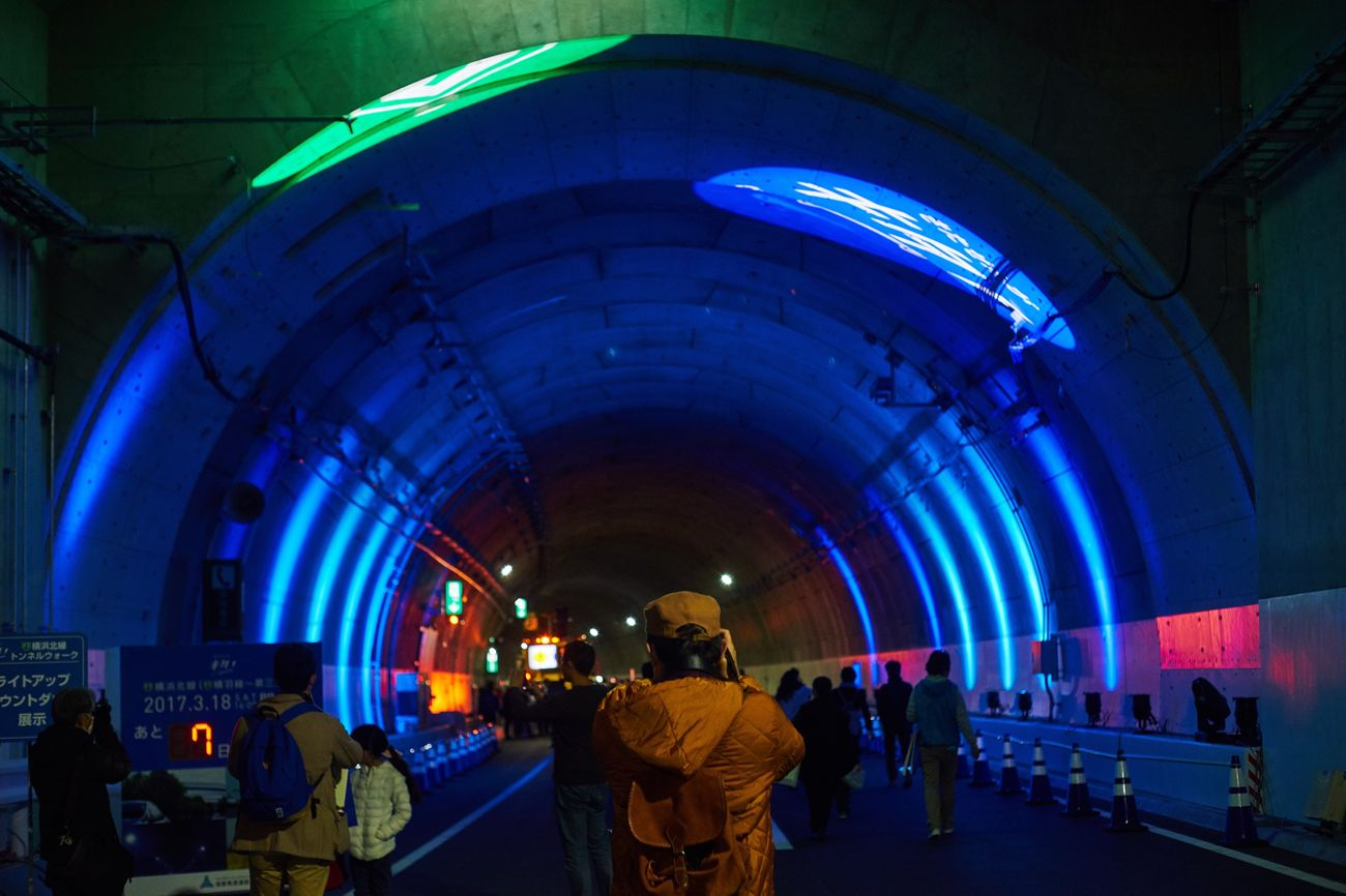 Illuminated Built Structure City Architecture Arch Tunnel Real People Group Of People Indoors  Bridge - Man Made Structure Night People Walking Around Eye4photography  EyeEm Best Shots Highway Tunnels Tunnel Vision Illumination People Photography Take Photos Road Blue Japan