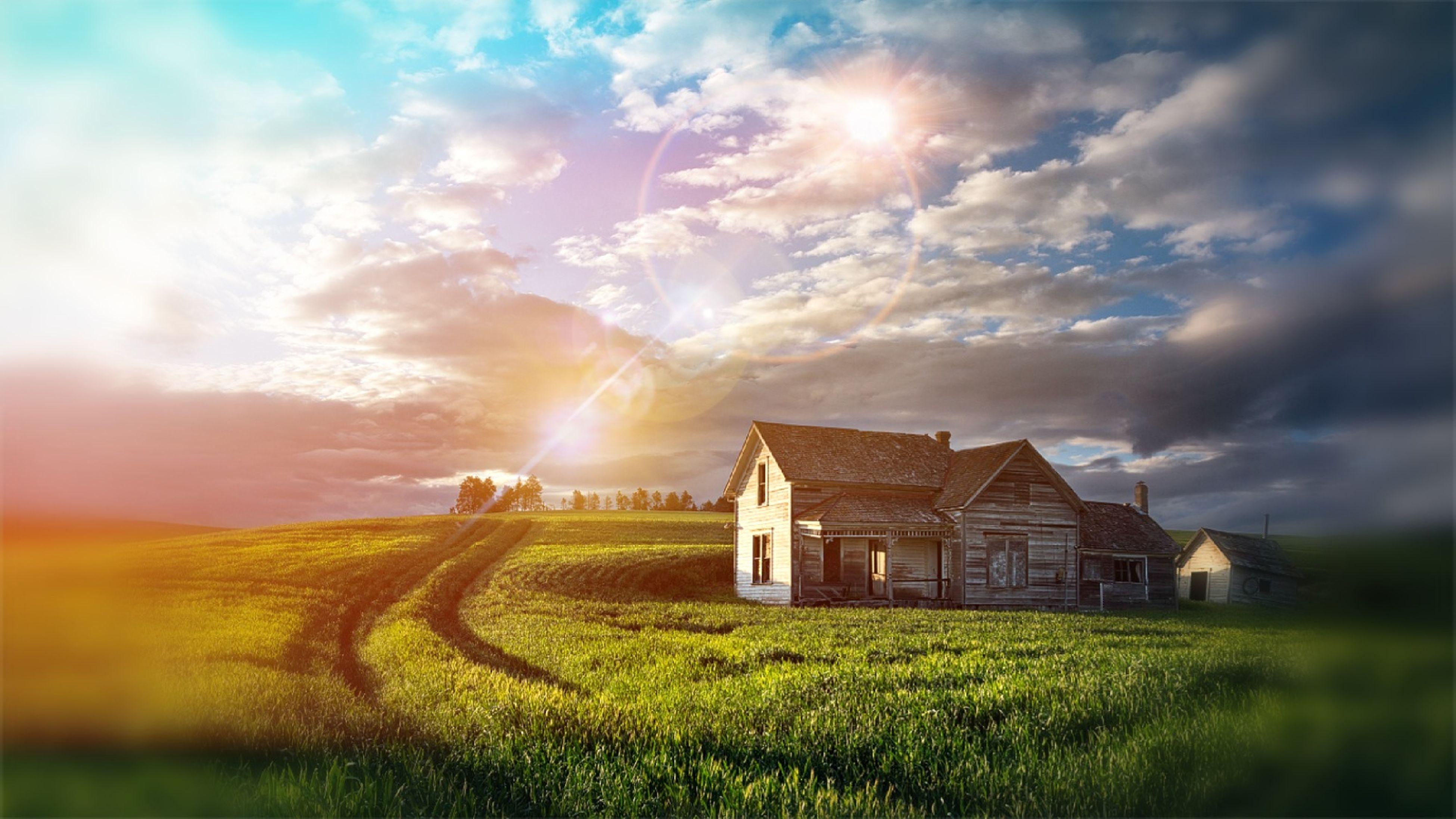 building exterior, field, sky, architecture, built structure, grass, sunbeam, landscape, sun, rural scene, sunset, cloud - sky, house, farm, sunlight, lens flare, nature, tranquil scene, agriculture, beauty in nature