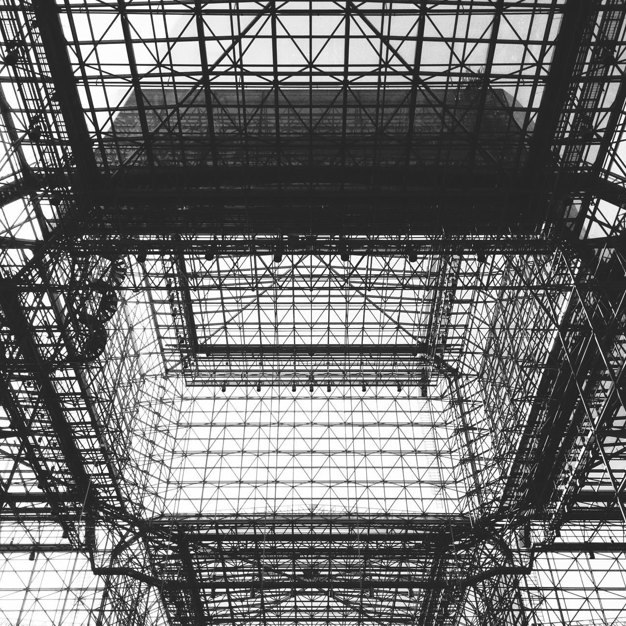 Javits Convention Center, New York City, USA. Photo by Tom Bland. Built Structure Architecture No People Metal Glass Roof Ceiling Looking Up IPhone IPhoneography Javits Center NYC New York City New York Lines Black And White Monochrome Architectural Glass Ceiling Graphic Convention Center Long Goodbye