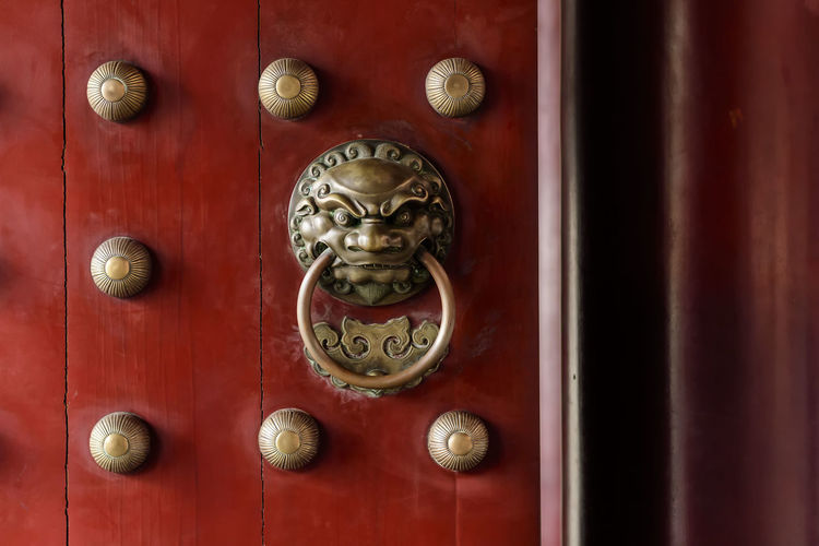 scenes at the Buddha Tooth Relic Temple in SIngapore Brass Buddhism Buddhist Temple Chinese Temple Doors Knocker Lion Place Of Worship Red Temple Temple Doors Traditional Architecture