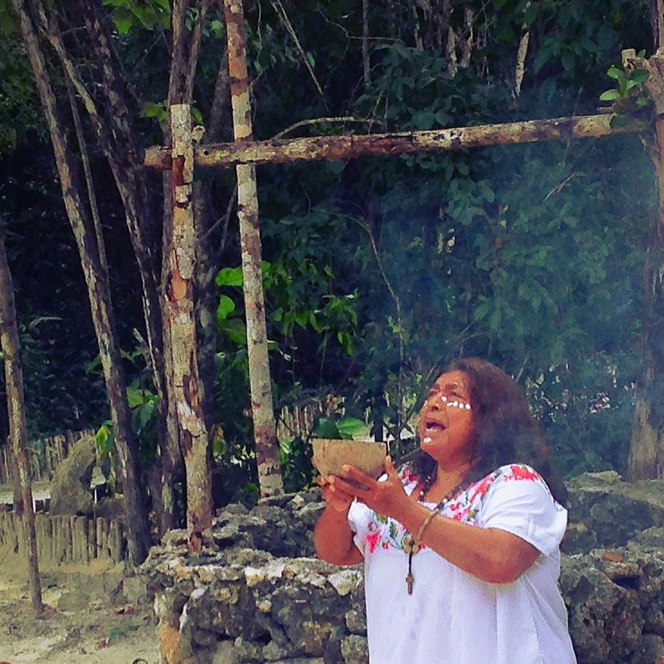 A Mayan descendent medicine woman performing a ceremony to the gods to allow us safe passage into the jungle. She was wonderful. Women Around The World One Person Tree Adult Forest Nature Mayan Rituals & Cultural Ceremony Safe Passage Jungle Fascinating Travel Things I See Tropical Smoke