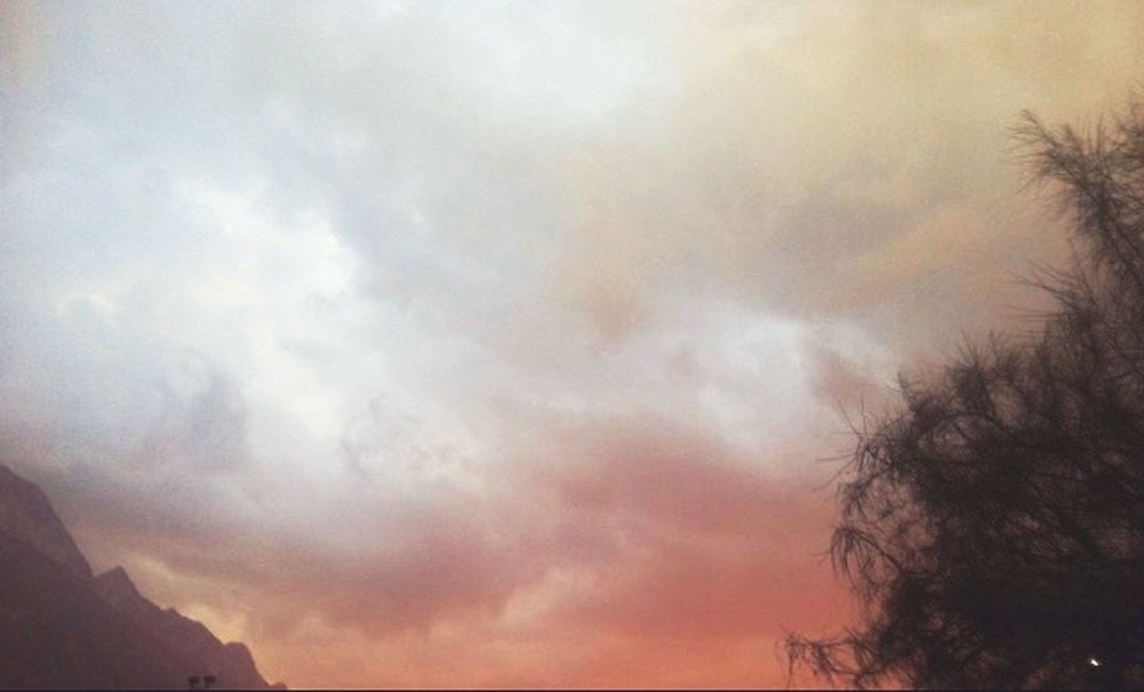 sky, cloud - sky, low angle view, cloudy, silhouette, weather, overcast, beauty in nature, tranquility, scenics, nature, tree, tranquil scene, dusk, storm cloud, sunset, cloud, dramatic sky, cloudscape, atmospheric mood