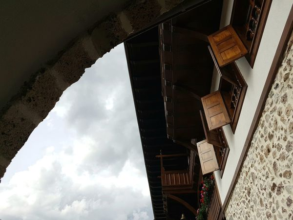 Monastery Jovan Bigorski Looking Up Low Angle View Windows Wooden Shutters Arch Architecture No People Day Sky Historical Building Historical Monuments Built Structure Architecture Religious Place Building Exterior Stone Material
