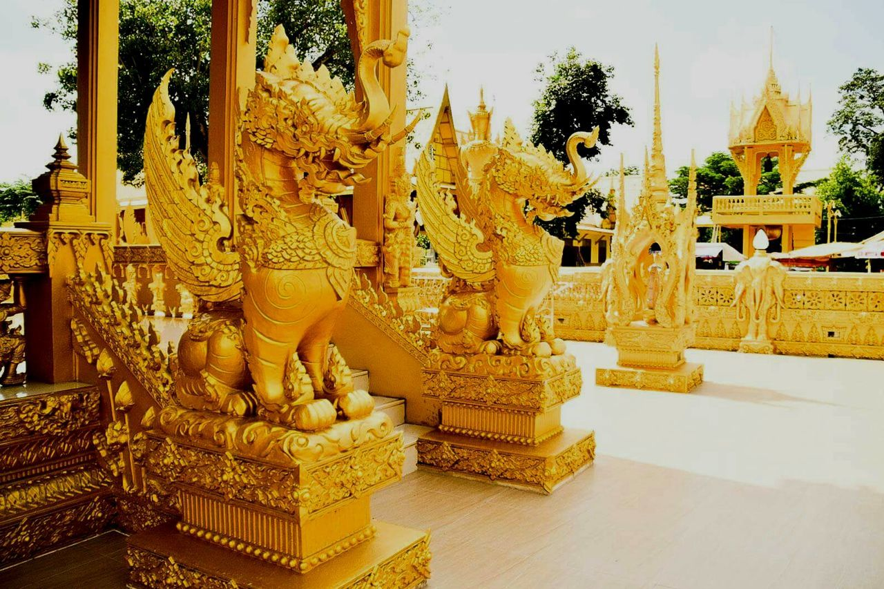 religion, statue, spirituality, sculpture, human representation, place of worship, male likeness, art and craft, gold colored, gold, history, built structure, architecture, idol, no people, ancient, travel destinations, golden color, building exterior, day, king - royal person, outdoors