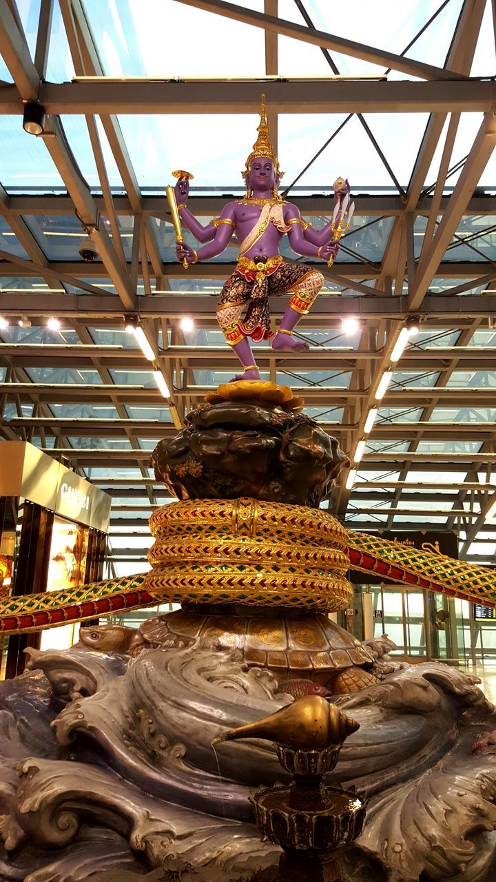 art and craft, statue, indoors, human representation, sculpture, low angle view, spirituality, no people, day, architecture