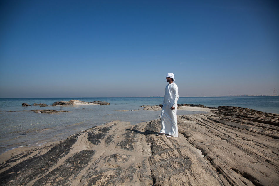 Adult Adults Only Arab Arab Man Beach Beauty In Nature Blue Clear Sky Day Emirati Full Length Horizon Over Water Nature One Person One Woman Only Only Women Outdoors People Sand Sea Sky Standing Water Young Adult