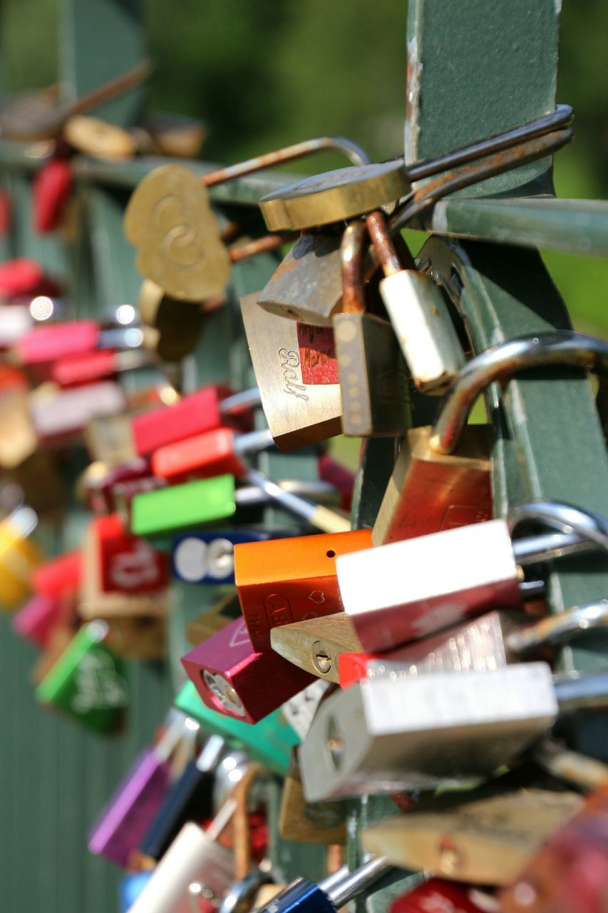 padlock, love lock, lock, metal, security, hope, love, safety, large group of objects, hope - concept, hanging, protection, abundance, railing, close-up, variation, luck, outdoors, no people, day, selective focus, multi colored