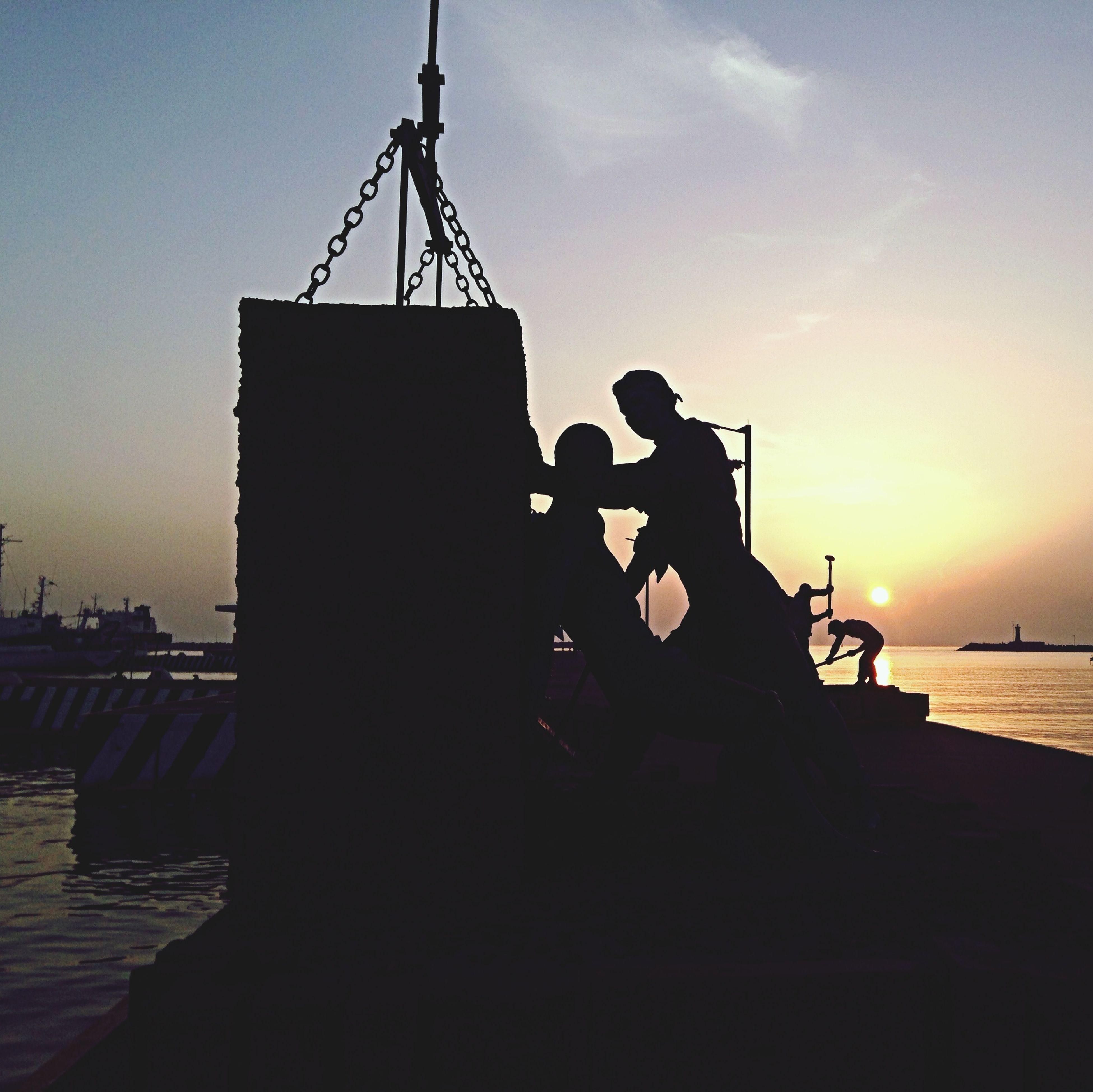 sunset, silhouette, sky, orange color, water, sun, nautical vessel, sea, built structure, transportation, mode of transport, crane - construction machinery, building exterior, architecture, sunlight, harbor, boat, outdoors, nature, dusk