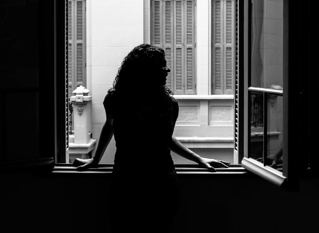 One Person One Woman Only Indoors  Window Real People Standing People Women Lifestyles Human Back Day Black & White Canon Rebel T3 Porto Alegre Architecture Mario Quintana Silluet Sillohouette Shadows & Light Urban Built Structure EyeEmNewHere EyeEm Best Shots The Portraitist - 2017 EyeEm Awards Fresh on Market 2017 Place Of Heart EyeEm Selects