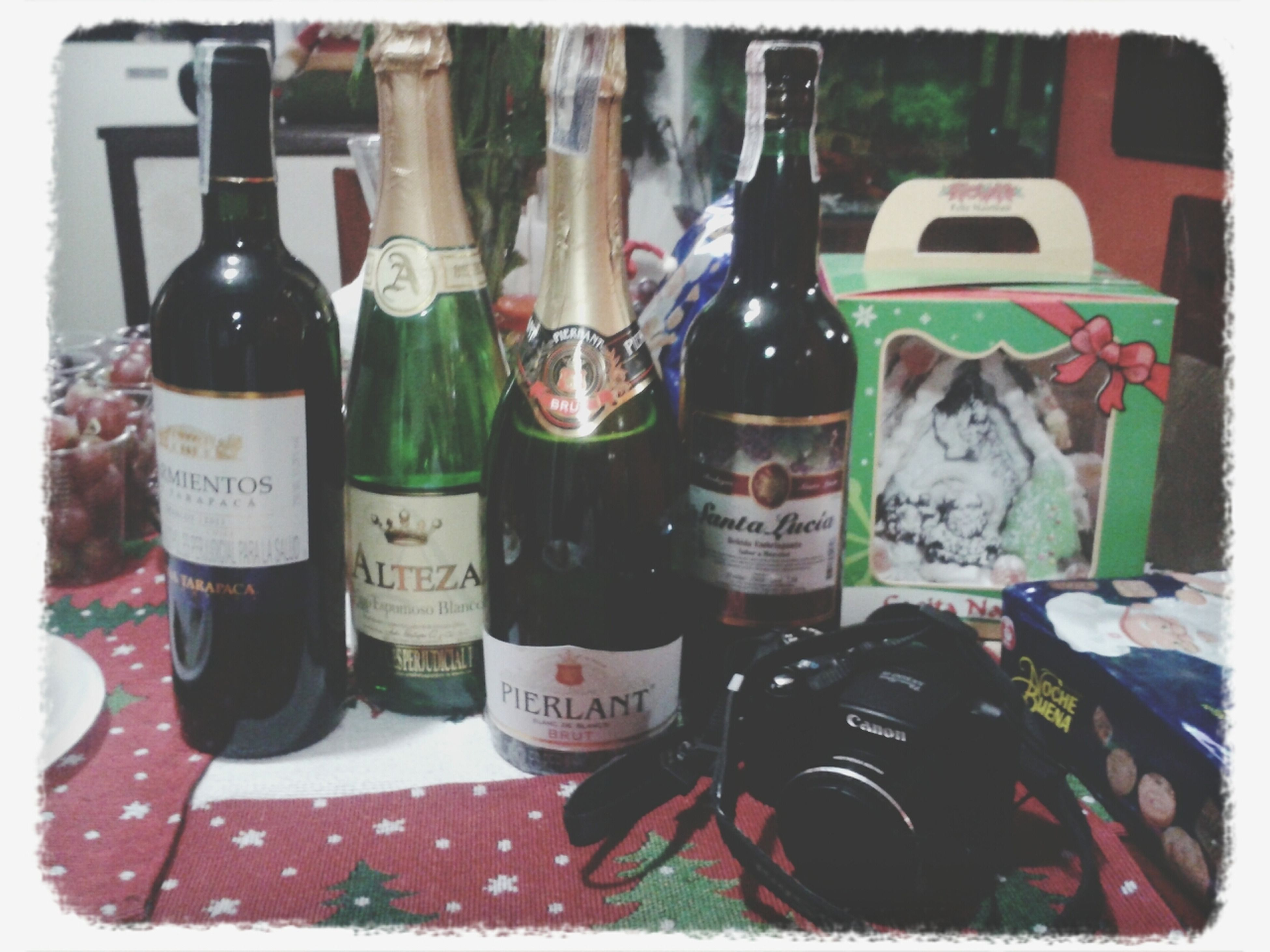 transfer print, still life, indoors, close-up, table, auto post production filter, variation, food and drink, bottle, glass - material, drink, choice, no people, focus on foreground, selective focus, high angle view, large group of objects, group of objects, drinking glass, day