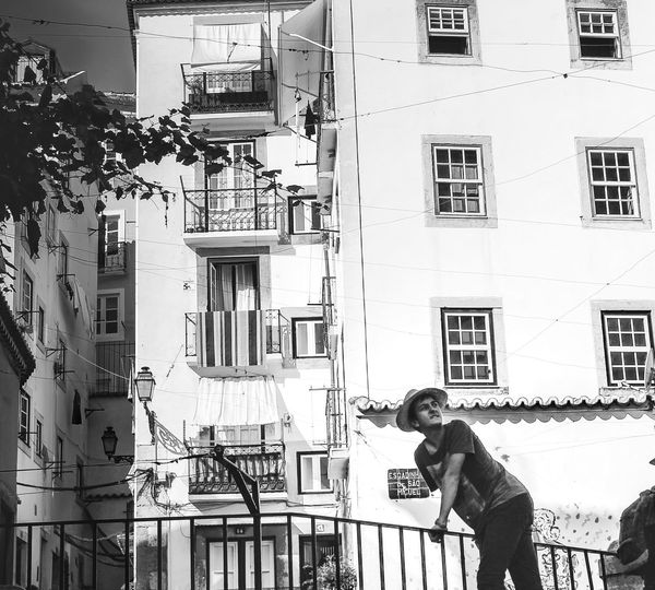 EyeEmNewHere One Person Men Real People Only Men Building Exterior Adults Only Architecture Built Structure One Man Only Day Adult City Outdoors People Lisbon Blackandwhite Windows And Doors Streetphotography Story First Eyeem Photo