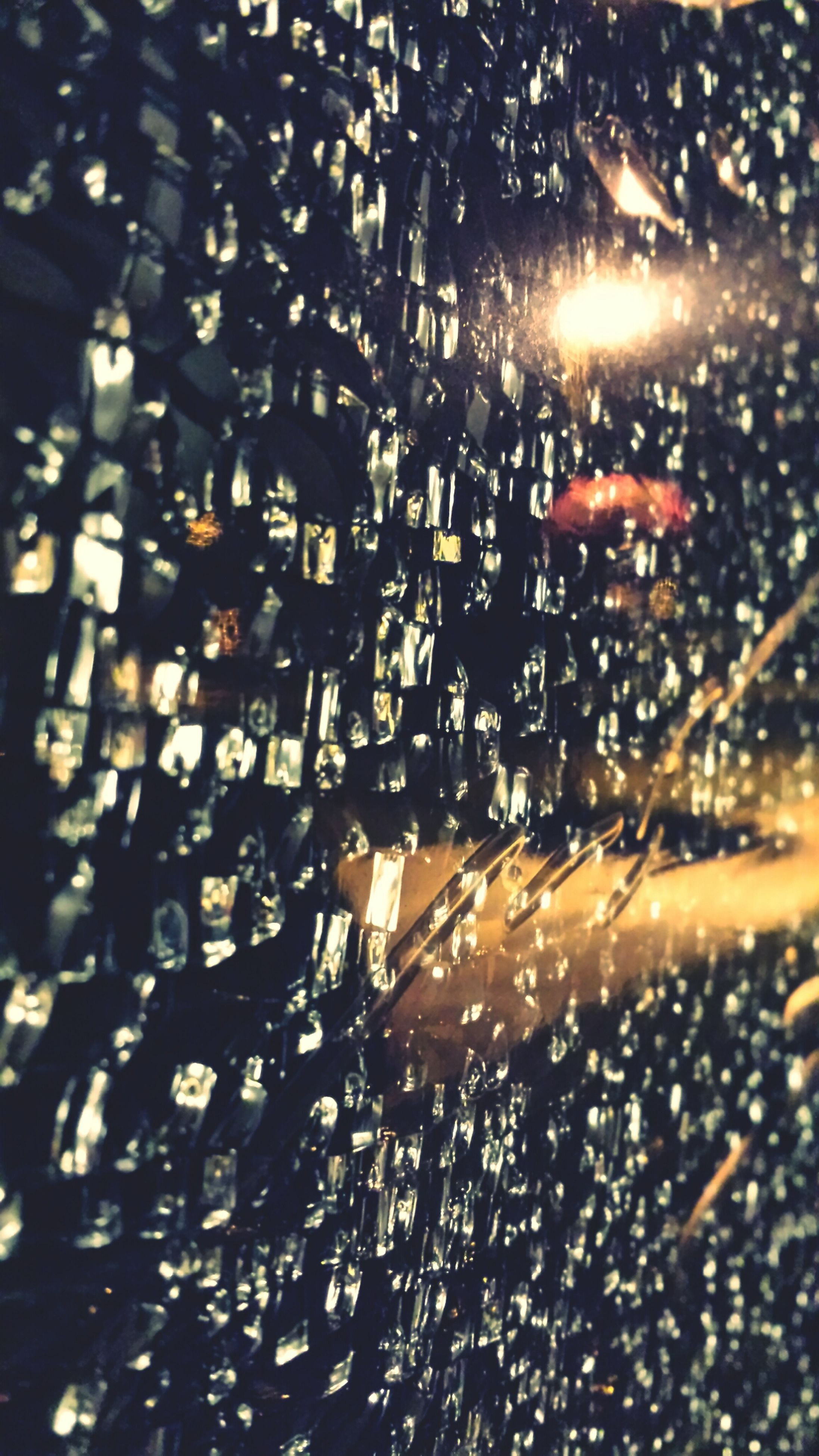 wet, full frame, rain, window, glass - material, illuminated, backgrounds, transparent, drop, water, night, indoors, season, city, raindrop, street, glass, no people, weather, building exterior