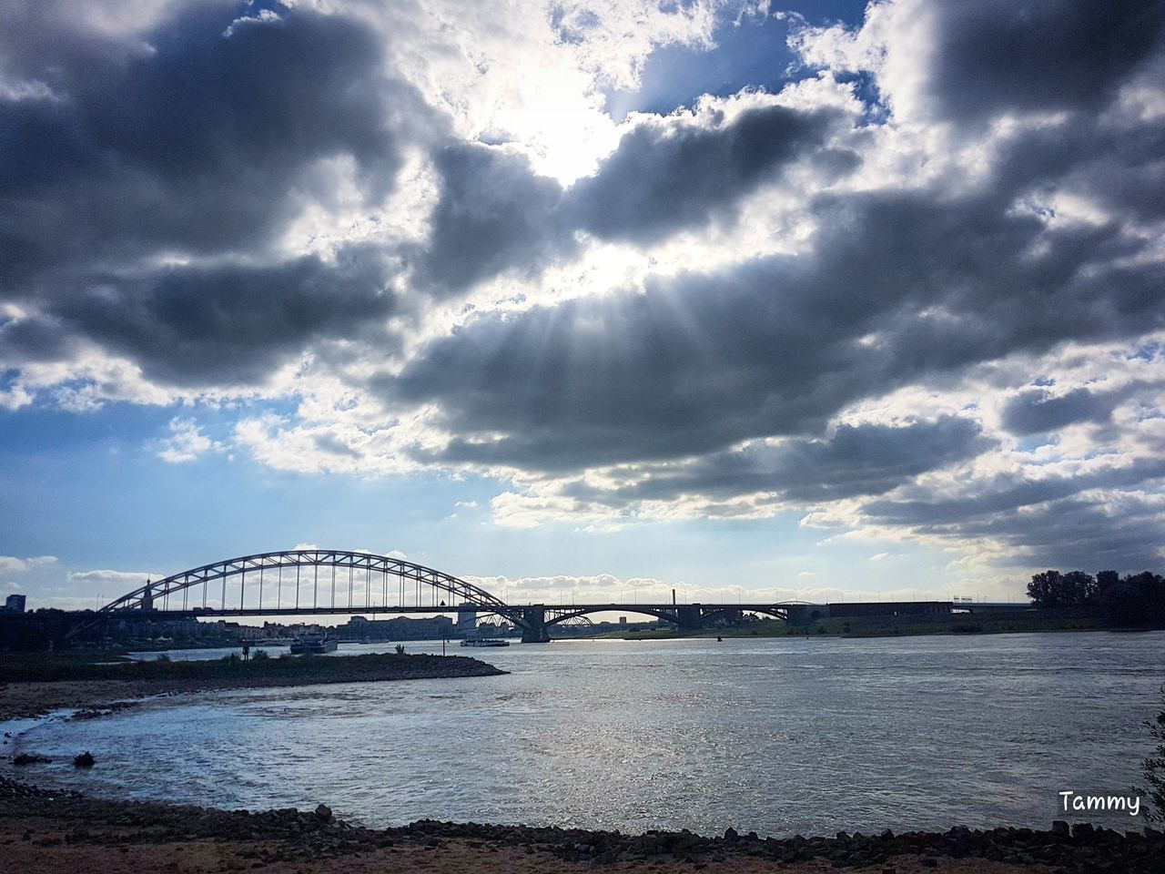 cloud - sky, sky, architecture, built structure, bridge - man made structure, connection, water, sea, no people, scenics, travel destinations, transportation, outdoors, building exterior, day, nature, tranquility, city, beauty in nature, cityscape