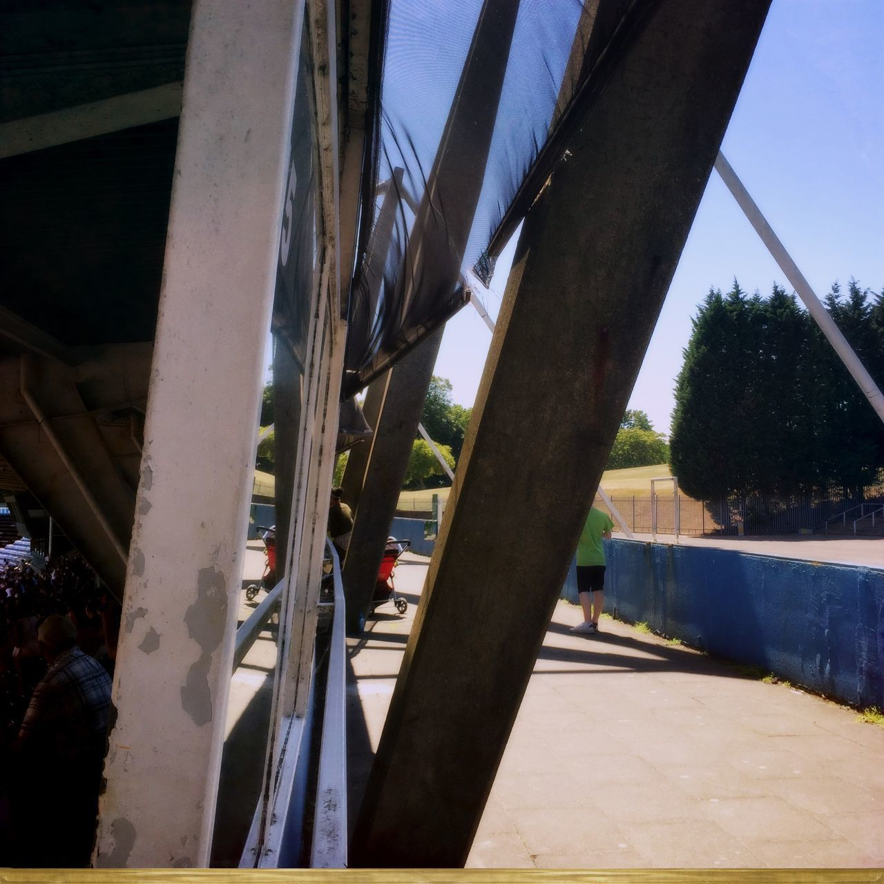 day, bridge - man made structure, sunlight, architecture, built structure, outdoors, tree, the way forward, sky, shadow, real people, close-up