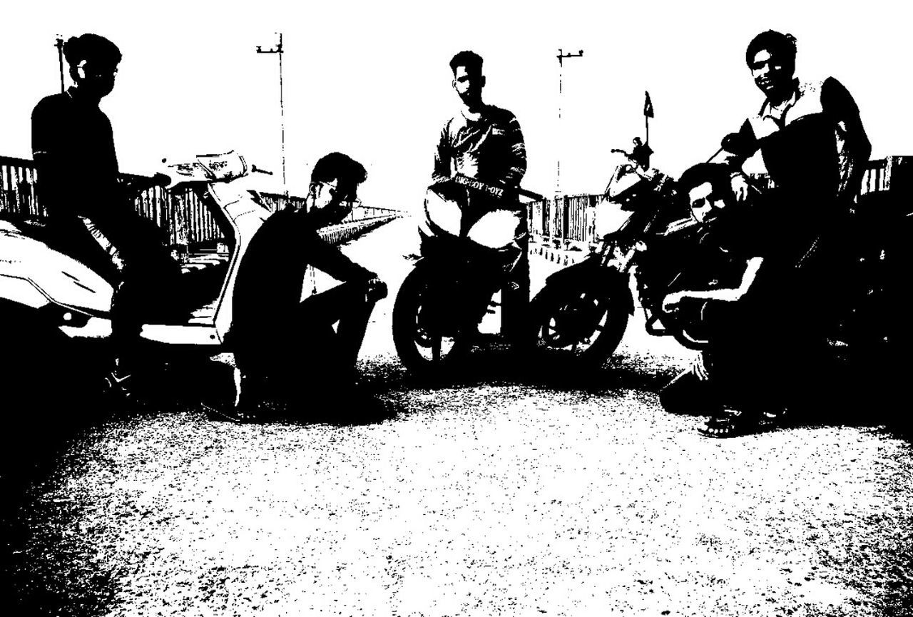 real people, men, lifestyles, transportation, sitting, leisure activity, motorcycle, full length, mode of transport, arts culture and entertainment, riding, performance, togetherness, outdoors, day, musician, biker, adult, people