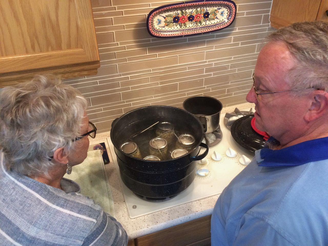 Home canning corn salsa, California Adult Canning Canning Jars Casual Clothing Day Eyeglasses  Food Gray Hair Healthcare And Medicine High Angle View Indoors  Lifestyles Men One Person Patient People Real People Senior Adult Senior Men Senior Women Water Bath