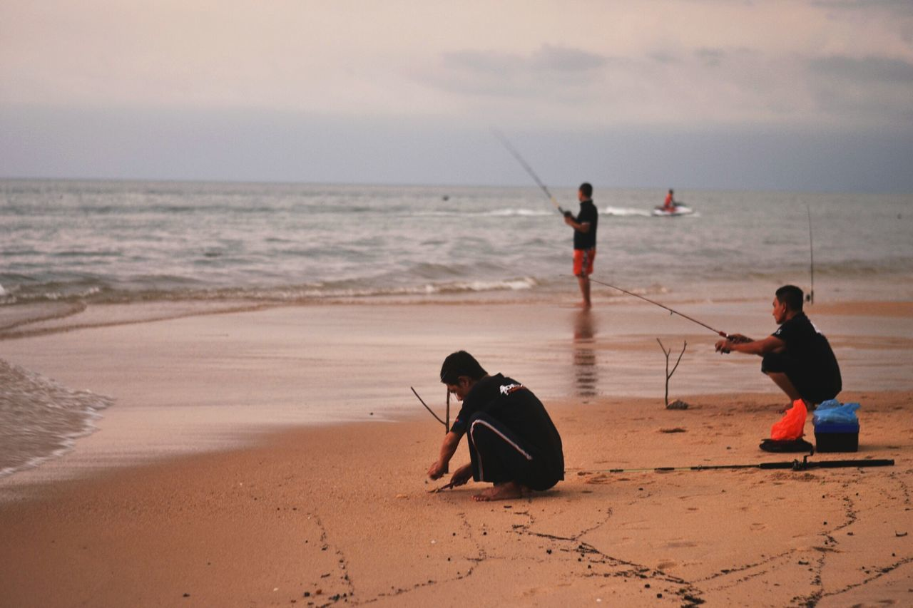 sea, beach, horizon over water, water, sand, real people, nature, men, fishing, leisure activity, sky, outdoors, boys, full length, day, standing, scenics, beauty in nature, people
