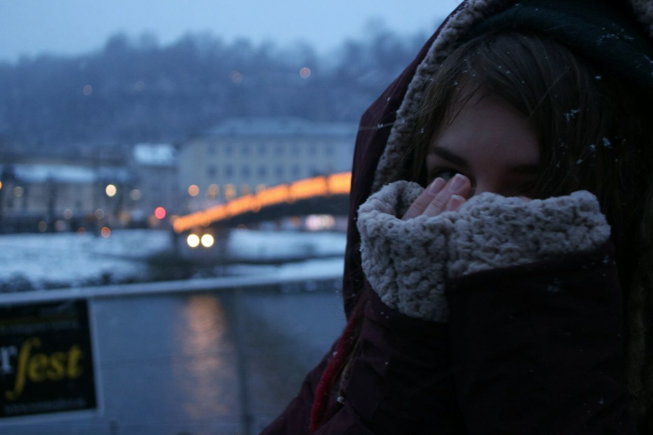 City One Person Night Twilight Dusk Focus On Foreground River Bridge - Man Made Structure Winter Rain Overcoat Warm Clothing Outdoors Hood - Clothing One Woman Only Watching Adults Only Young Adult People Human Body Part