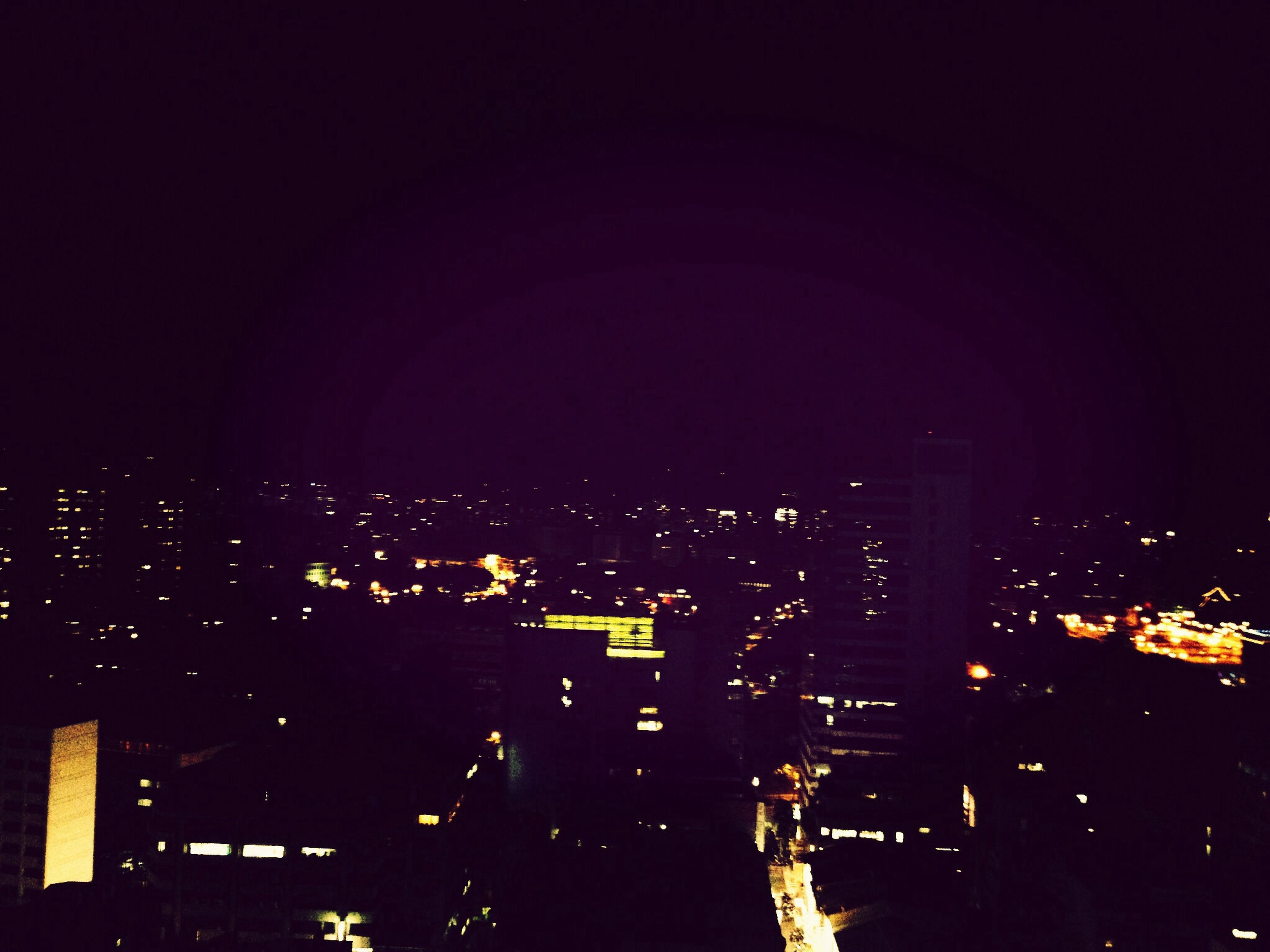 night, building exterior, city, illuminated, cityscape, architecture, built structure, crowded, high angle view, residential district, dark, copy space, residential structure, residential building, city life, skyscraper, sky, aerial view, clear sky, office building
