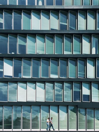 ::: Strideby Modern Architecture Modern Architecture Office Building Glass Façade Two Men Walking Showcase July