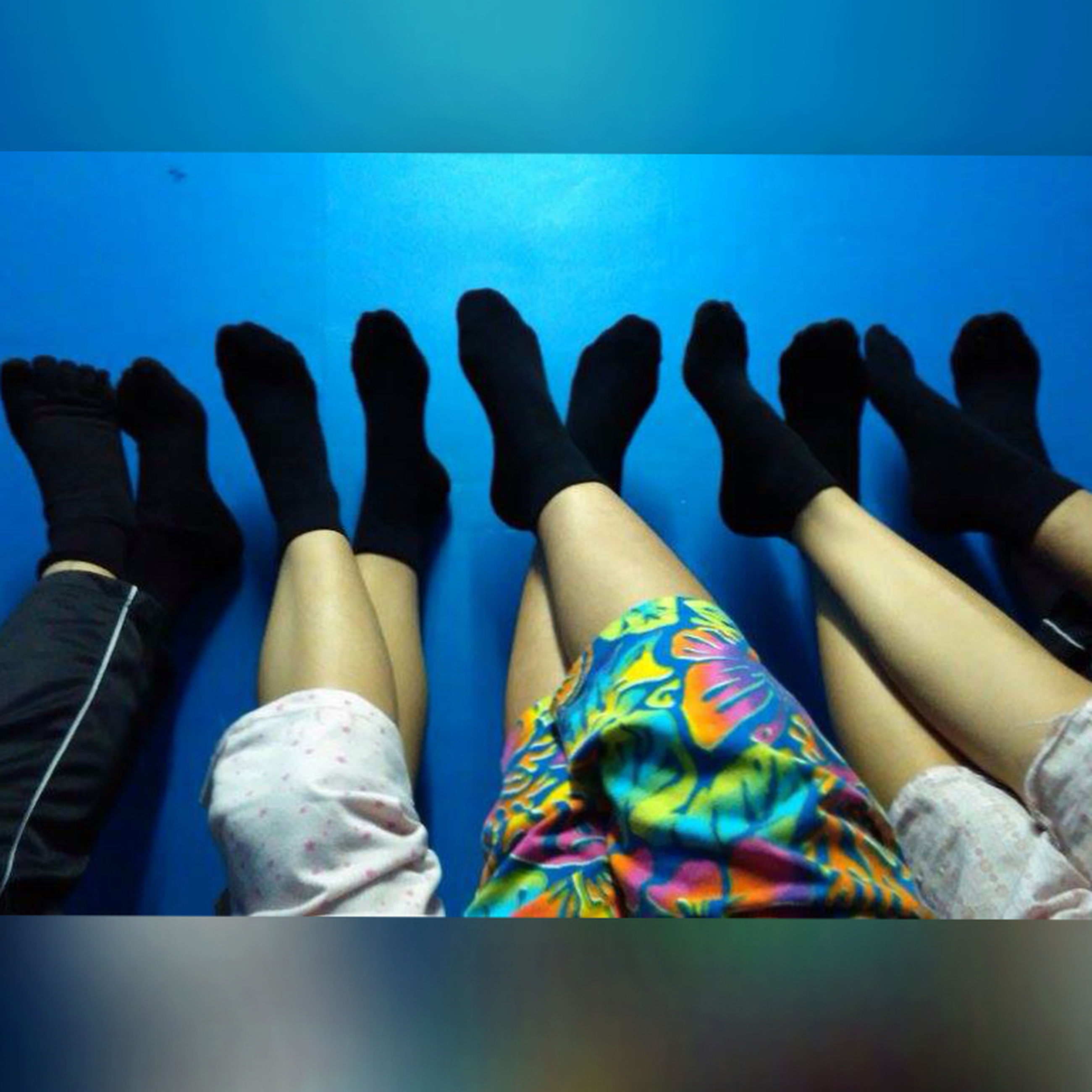lifestyles, person, low section, leisure activity, sitting, blue, relaxation, standing, men, shoe, casual clothing, togetherness, day, human foot, personal perspective, outdoors