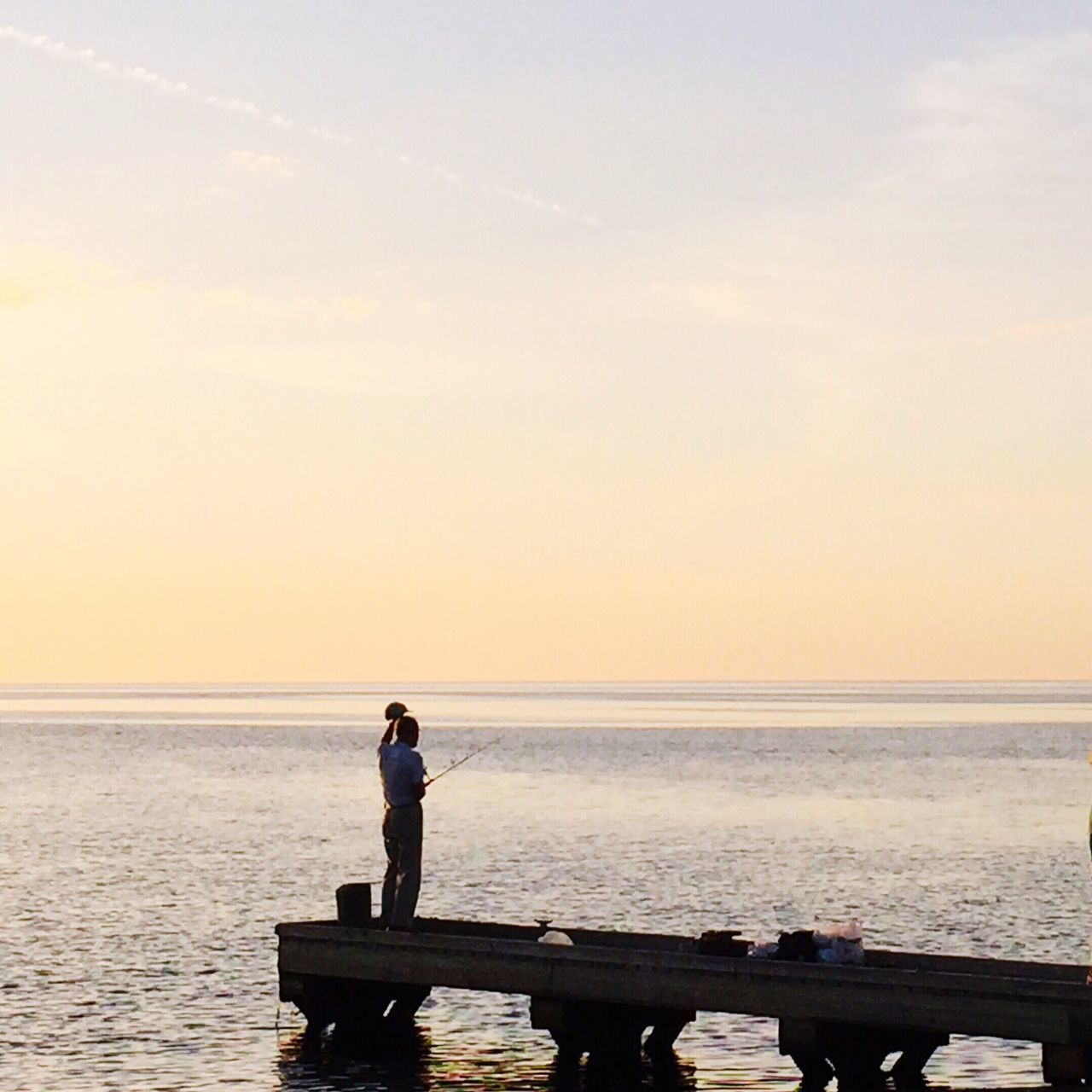 Horizon Over Water Sea Real People Full Length Water Sky Sea And Sky Seascape Leisure Activity Fishing Man Sunset Beauty In Nature Nature Relaxation Idyllic Clear Sky Tranquil Scene Outdoors Scenics Waterfront Getting Away From It All Silhouette