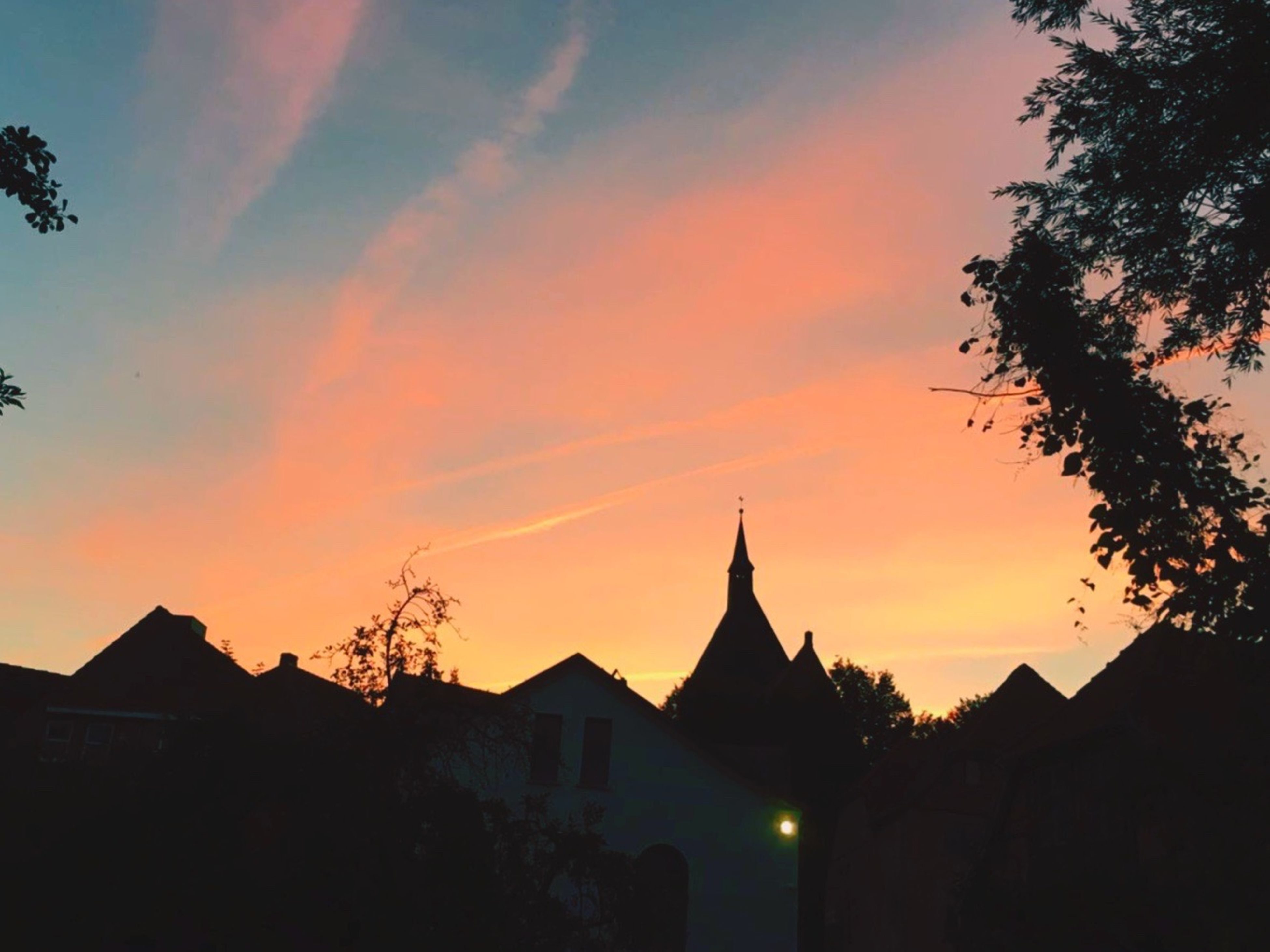 The sky took its cue, every color and hue. A magical sunset in Mölln Sky Silhouette Beauty In Nature Sunset Place Of Worship A Week On Eyeem Sunset Silhouettes Small Town