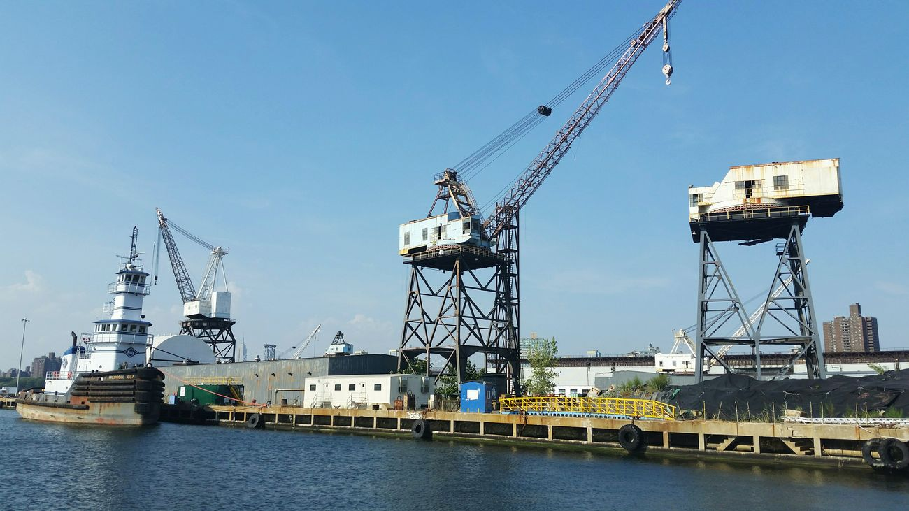 Brooklyn Navy Yard old cranes historical landmark boat docks repair ships Barge Boat House Williamsburg Bridge Warehouseproject