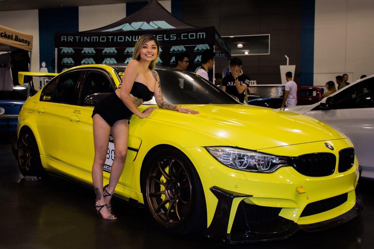 Tattoo Girls With Tattoos EventPhotography Car Show Capture The Moment Natural Beauty Let Your Hair Down Long Hair Photoshoot Portrait Of A Woman Women Who Inspire You Modeling Model Pose Smile Pretty Athleisure Throughmyeyes Taking Photos Portrait Portrait Photography Event Bmw