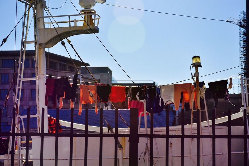 Colour Of Life Shiplife Hanging Laundry Drying Clothes Harbor View Getty Images Nationalgeographic Moments Reallifeeveryday Dirtylaundry Clothesline Shiplife⚓ Highseas Harbor: Port, Dock, Haven, Marina; Mooring, Moorage, Anchorage; Waterfront, Harborside