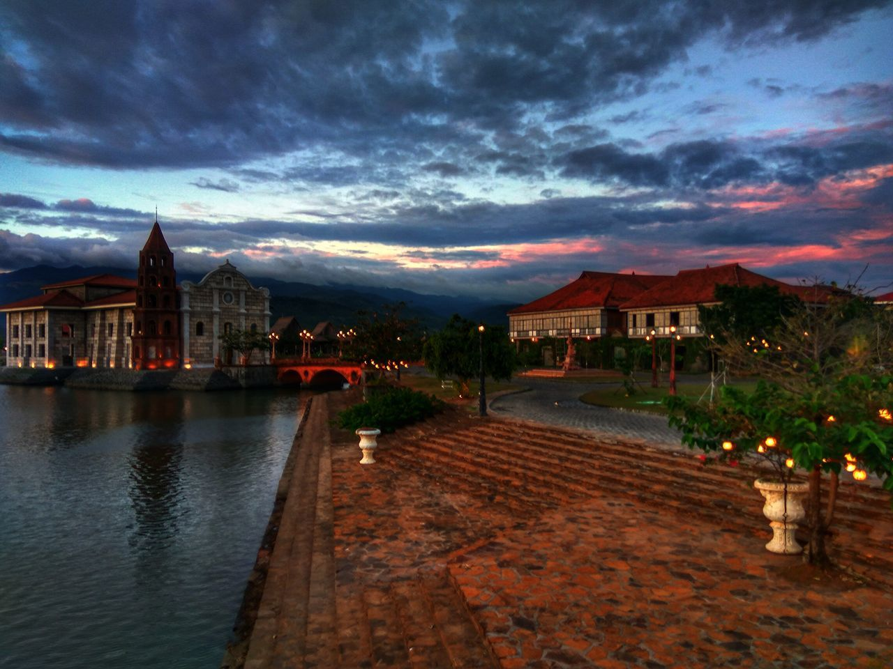 Architecture Building Exterior Dusk Travel Destinations Built Structure Sky Cloud - Sky Water Travel Reflection Bridge - Man Made Structure Illuminated City Sunset River No People Outdoors Cityscape Night History Lascasasfilipinasdeacuzar Bataan Philippines Tour Travelphotography
