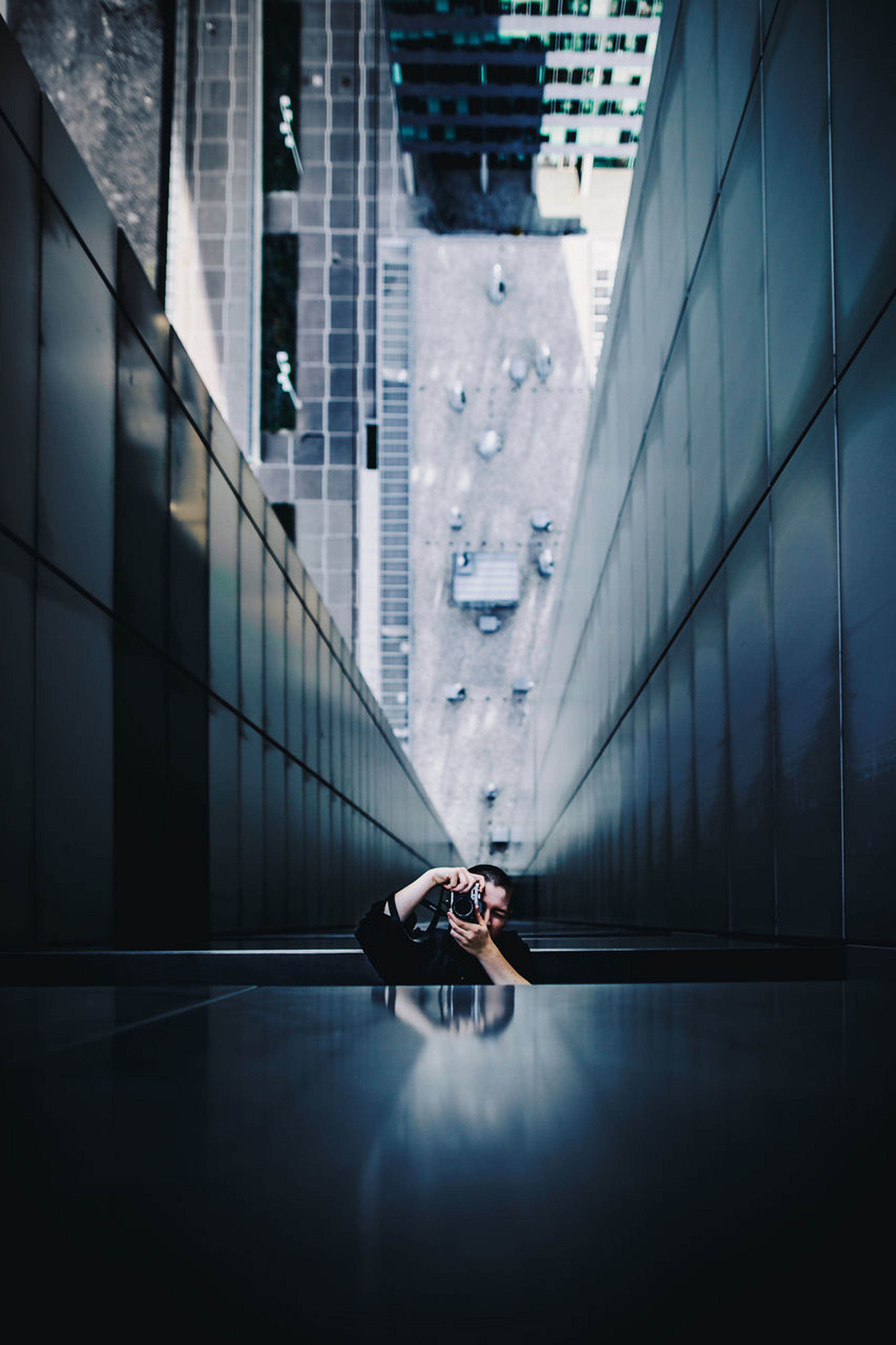 architecture, reflection, real people, built structure, building exterior, one person, window, full length, day, city, men, skyscraper, indoors, modern, women, people