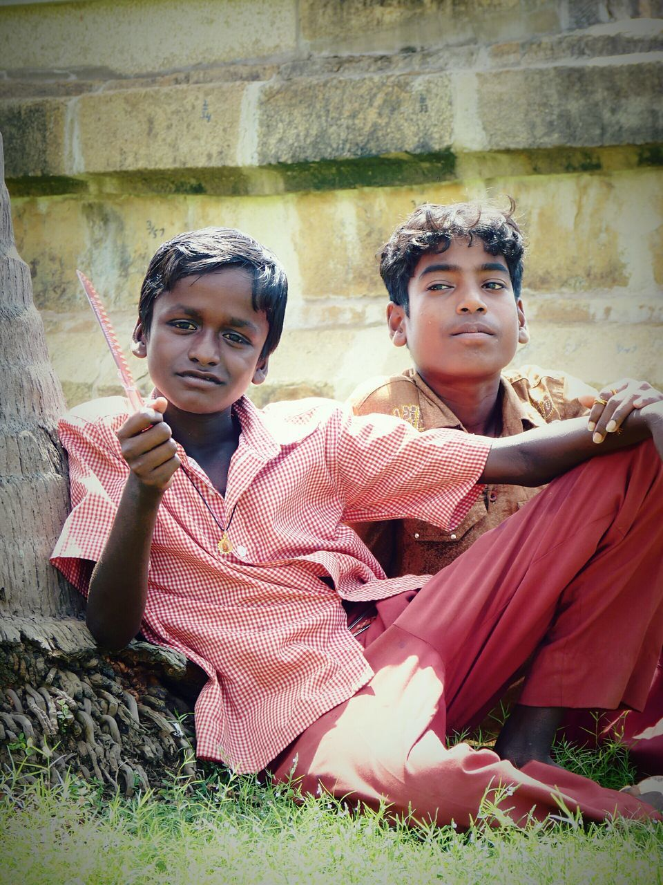two people, boys, real people, sitting, day, childhood, looking at camera, outdoors, togetherness, portrait, architecture, friendship, young adult, people