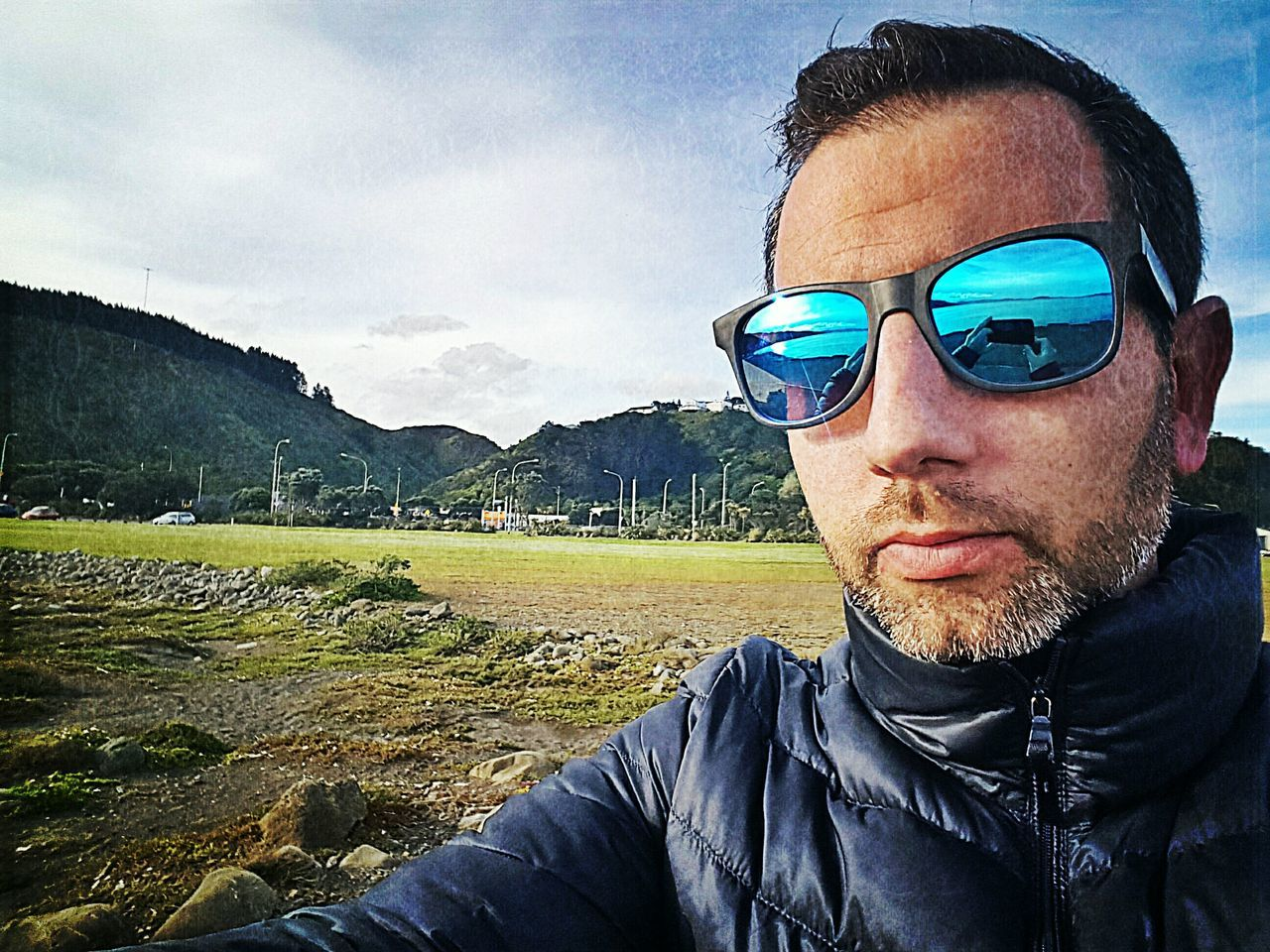 sunglasses, one person, mid adult, real people, sky, day, headshot, outdoors, portrait, landscape, nature, mountain, lifestyles, men, beauty in nature, one man only, adult, people
