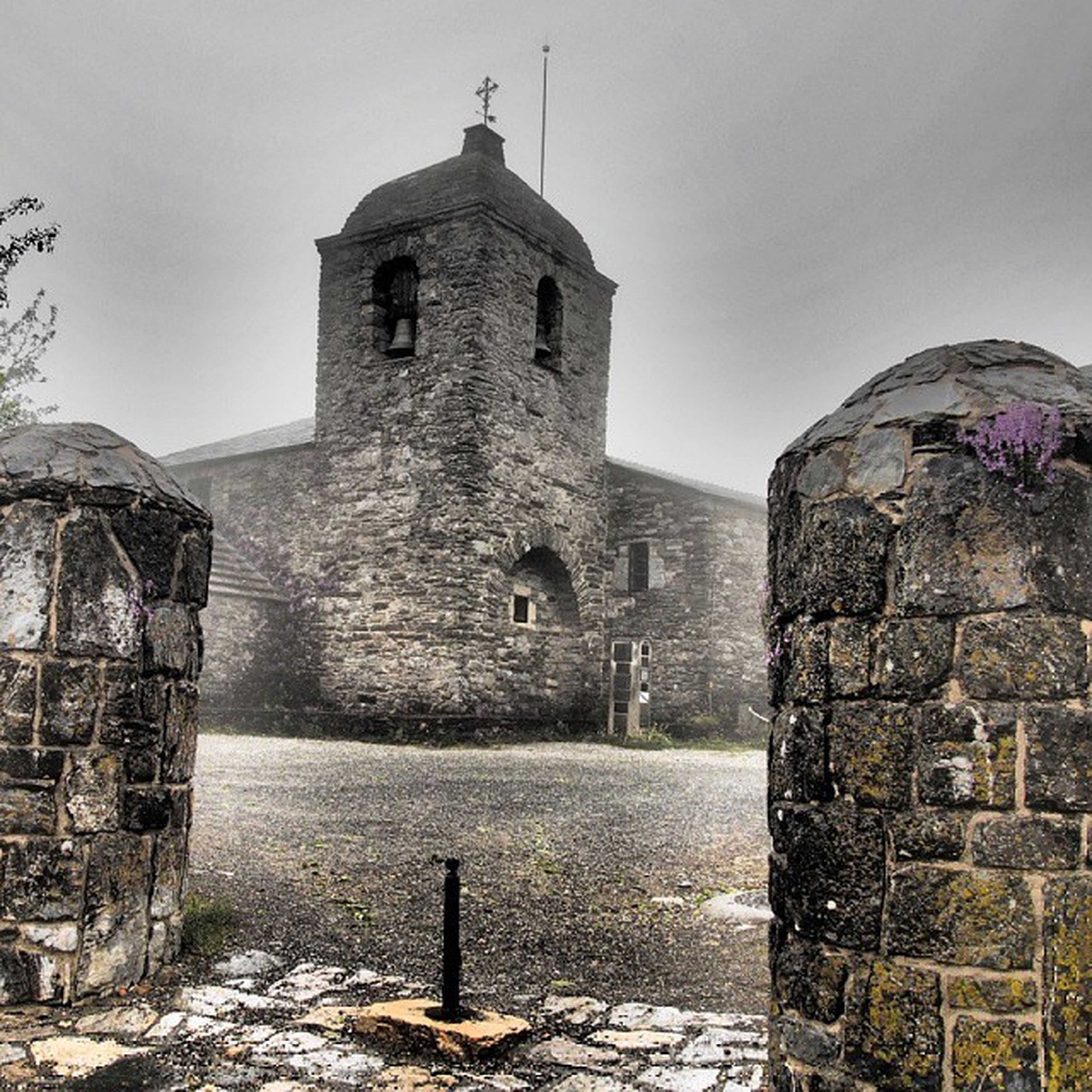 architecture, built structure, building exterior, stone wall, religion, church, history, place of worship, old, sky, spirituality, wall - building feature, day, outdoors, clear sky, the past, the way forward, low angle view