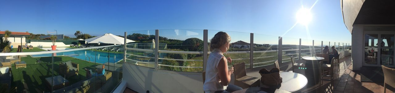 built structure, architecture, real people, sunlight, leisure activity, day, building exterior, outdoors, panoramic, arts culture and entertainment, clear sky, sky, water, one person, people
