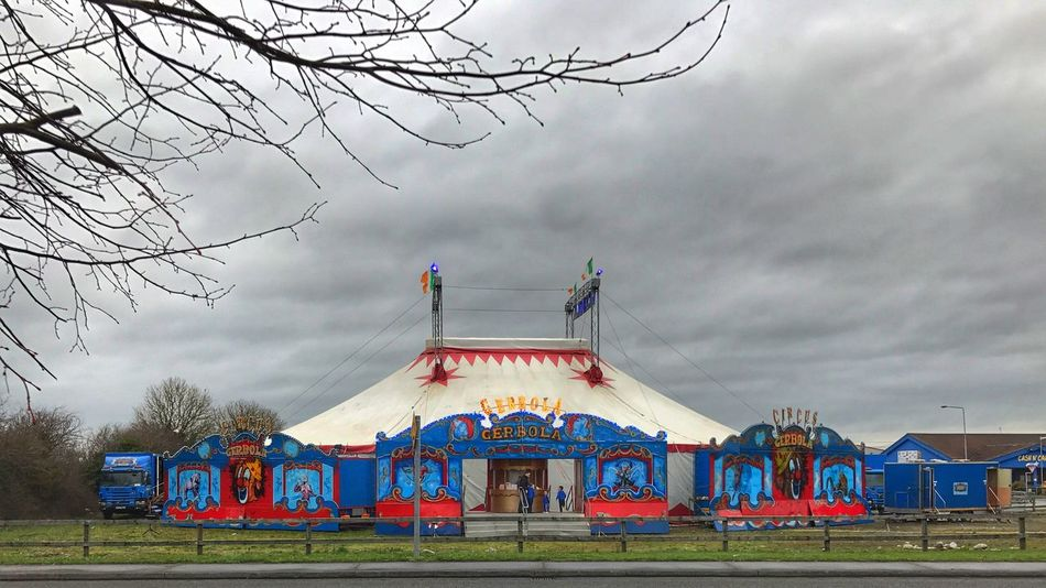 Circus is in town Sky Cloud - Sky Architecture Built Structure Outdoors Building Exterior Day Bare Tree Tree No People Circus Circus Tent Circus Performer Circus Skills