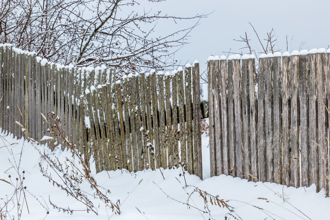 Old wooden fence with snow Background Branch Cold Temperature Countryside Day Fence Landscape Nature No People Outdoors Relaxing Rural Rural Scene Snow Tree Village White Winter Winter