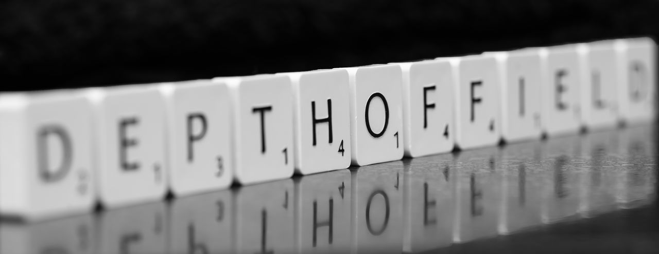 Depth of Field Backgrounds Black And White Close-up Depth Of Field Full Frame Scrabble Scrabble Tiles Tiles Black Background Black Backdrop Metaphor Photography Photographic Terminology