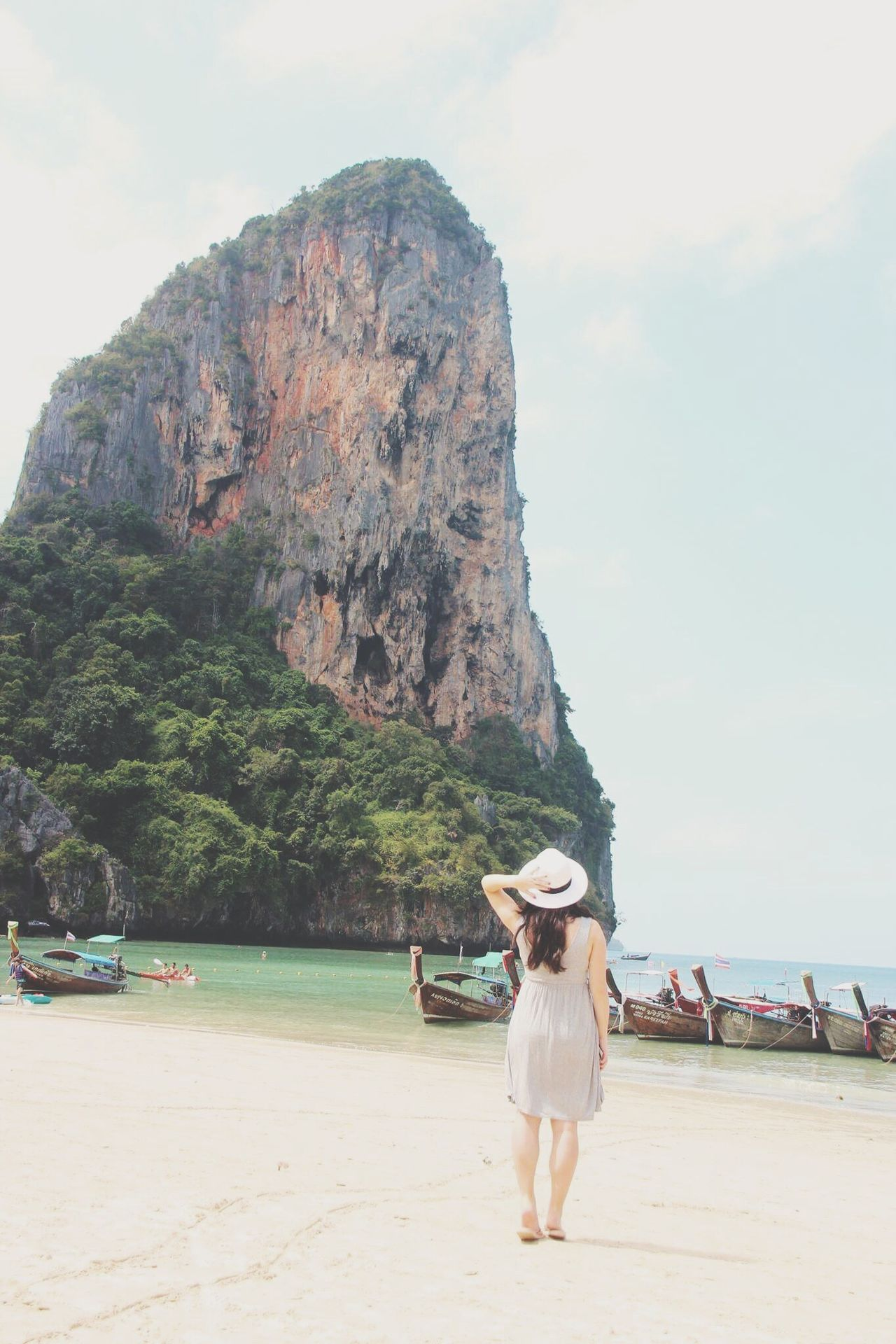 Thailand Travel Destinations Vacations Beauty In Nature Outdoors Beach Rear View Leisure Activity Only Women Tranquility One Woman Only (null)Day Railay Beach