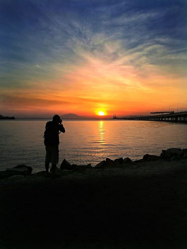 Sunset Silhouette Reflection Sky Photographer Camera - Photographic Equipment Beauty In Nature Photography Themes Outdoors Nature Beach Sunrise_sunsets_aroundworld Sunrise Silhouette Sunrise