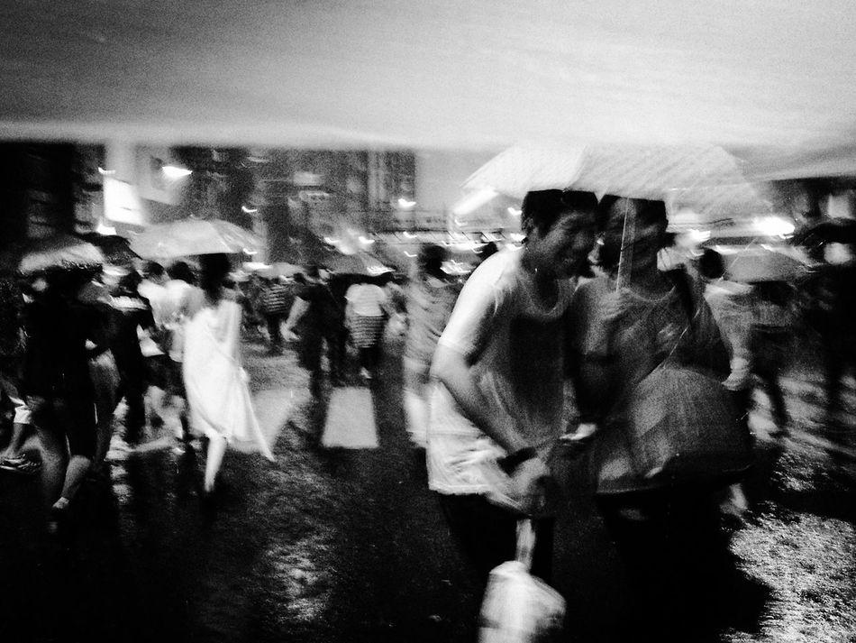 When the Rain suddenly interrupts a festival Rainy Days sStreet Photography The Street Photographer - 2014 EyeEm Awards RePicture Friendship