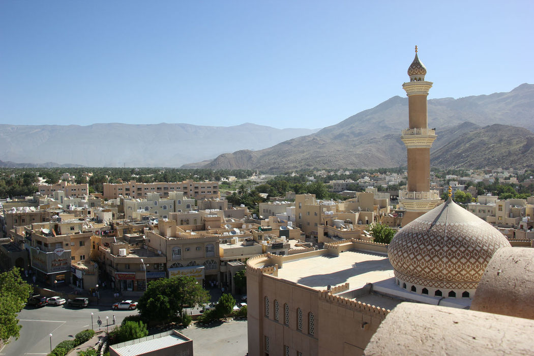 Arabic Arabic Architecture Architecture Beauty In Nature Building Exterior Clear Sky Day Minaret Mountain Nature Nizwa Nizwa Fort No People Oasis Oman Outdoors Sea Sky Skyline Spirituality Tranquility Tree