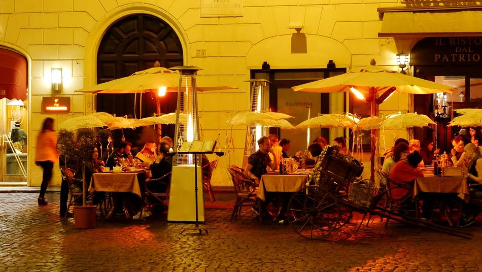 Enjoying the warm evening Cities At Night Eyeem Awards 2016 Restaurant Smallstreet Near Trevi Trevi City By Night Enjoying Life Warm Weather Eating With Friends Light Warm Lights Dinner Time Dinner With Friends Rome Italy Life On The Streets Cities At Night Street Photography Rome Italy Feel The Journey Golden Moment 43 Golden Moments