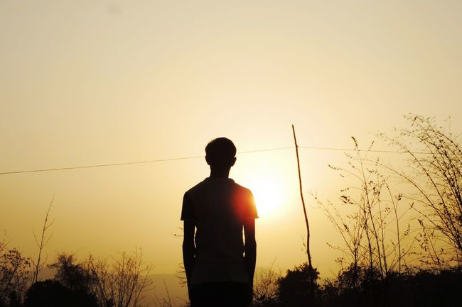 Standing Sunset Three Quarter Length Sun Clear Sky Outdoors Vibrant Color Rear View In Front Of