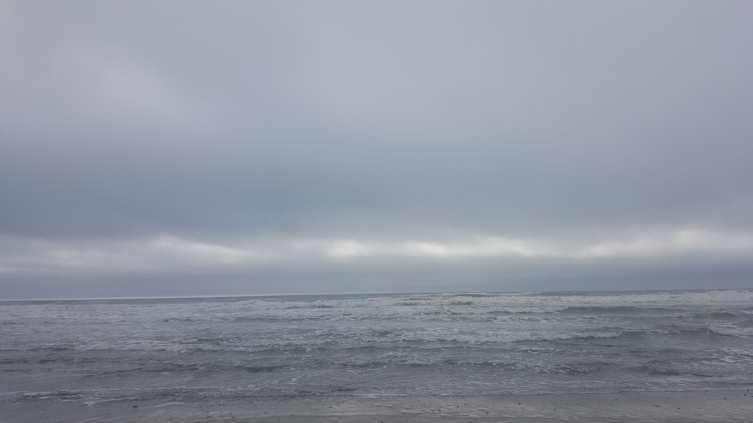 sea, sky, horizon over water, tranquil scene, water, scenics, tranquility, beauty in nature, cloud - sky, cloudy, nature, beach, weather, waterfront, overcast, idyllic, shore, cloud, remote, outdoors